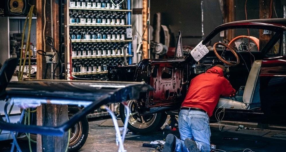 auto mechanic fixing a car